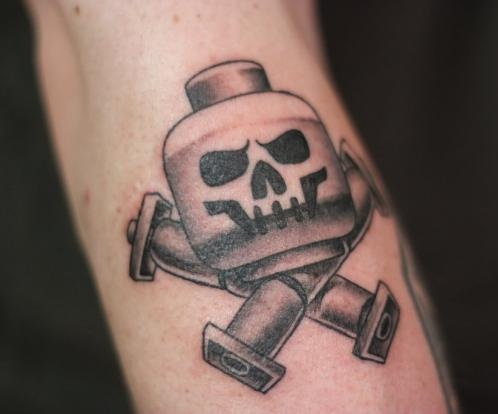 Crossbones Lego tattoo