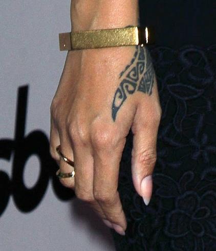 Dragon claw tribal tattoo