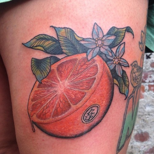 Half Orange with Green Leaves Tattoo Design