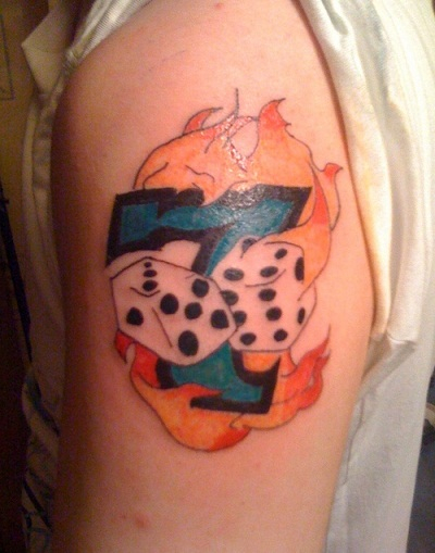 Lucky number dice tattoo on flames