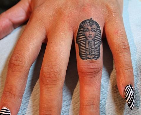 Small finger Black ink King Tut tattoo design