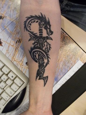 Sword dragon tribal tattoo