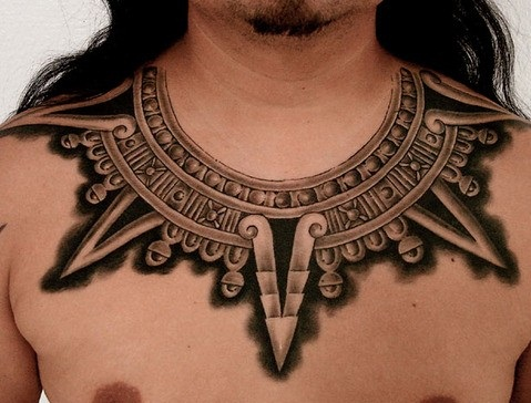 Tribal collar bone tattoo