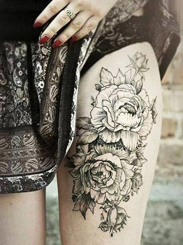 Black and white thigh peony tattoo