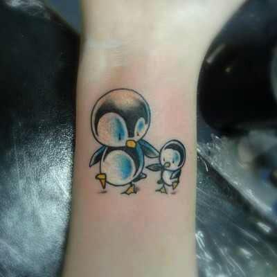 Budding Penguin Tattoo