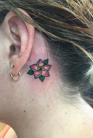 CutePlumeria Tattoo behind an ear