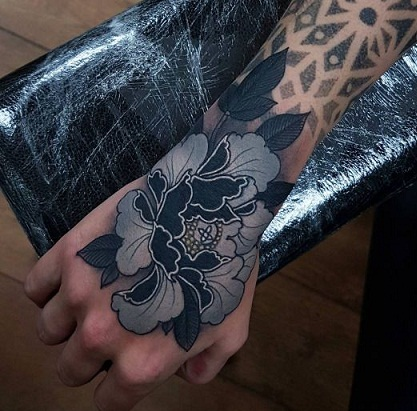 Grey and black peony tattoo