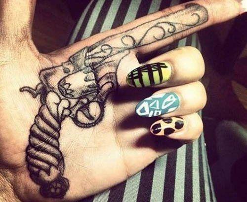 Gun Style Palm Tattoo