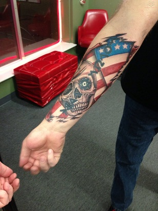 Patriotic skull and flag tattoo