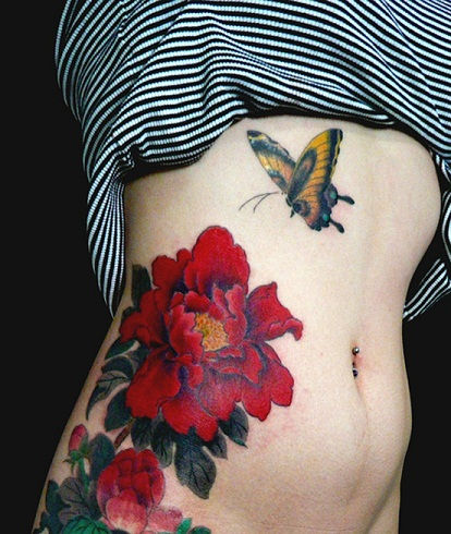 Red peony tattoo on body