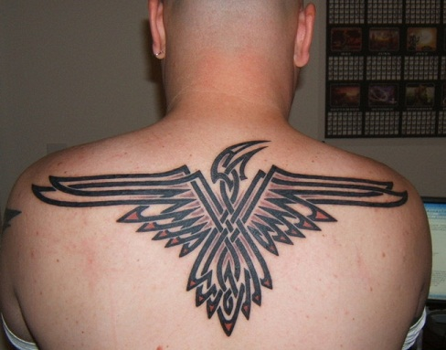 Egyptian Style Tribal Back Tattoo