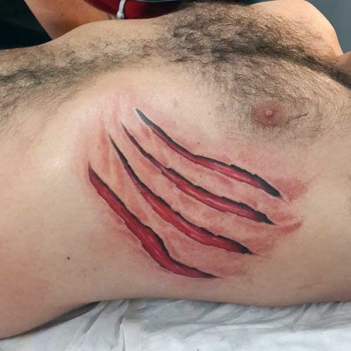 ripped skin tattoo