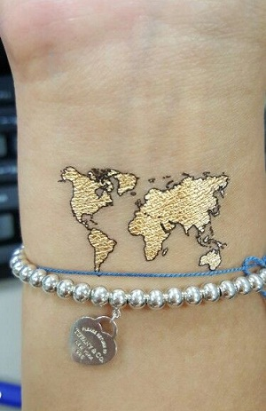 9 best world map tattoo designs ideas and meaning for adventurers lovely world map tattoo designs gumiabroncs Gallery