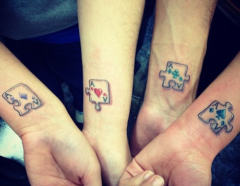 Puzzle Piece Sibling Tattoos