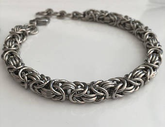 Fashion jewelry is the modern theme for the 11th anniversary gift ideas. This cool twisted bracelet is perfect as a fashion jewelry item to give your wife.
