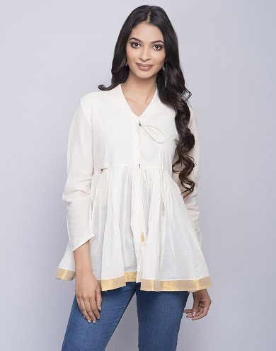 51d2f50ca95 Office Wear Short Kurti. This plain white kurti with jeans ...