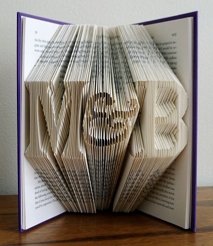 This is a serious paper wedding anniversary gift that you can gift someone. The pages of the book are folded in such a way that you can read the initials of ... & 9 Creative and Awesome Paper Anniversary Gifts | Styles At Life