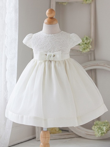 c403faea6b702 Christening is an important milestone in a child s life and a white baby  dress with cap sleeve and embroidered lace on bodice is perfect for the  occasion.