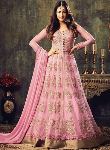 836e8e7c7e0d8 Win your man's heart in this beautiful Pink Net Salwar Suit. The floor  length Anarkali Salwar suit is heavily embellished with golden thread work  and lace ...