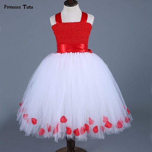 ec31947b1f4 A beautiful baby Christmas dress with red bodice and white net flare  embellished with flowers is perfect for a Christmas party or holiday wear.