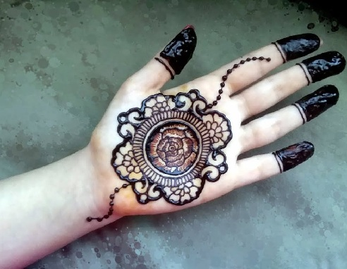 Traditional Mehndi Designs Photos : Latest and popular gol tikka mehndi designs styles at life