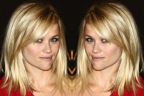 Medium Blonde Hairstyle with Side Swept Bangs