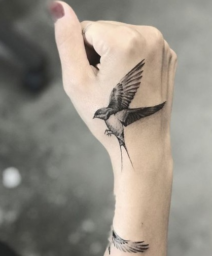Bold and Modern Sparrow Tattoo Idea