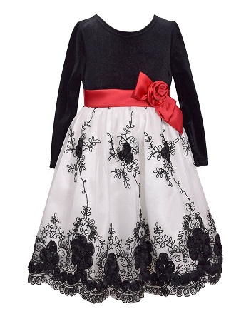 7699b828ad91 This is a cute black and white velvet frock for girls. This is a scoop neck  velvet and satin dress with flower decoration. Pair it with your favorite  shoes ...