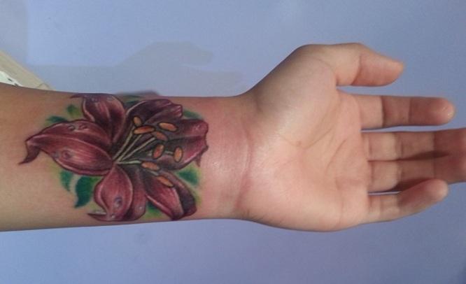 lily tattoos on wrist