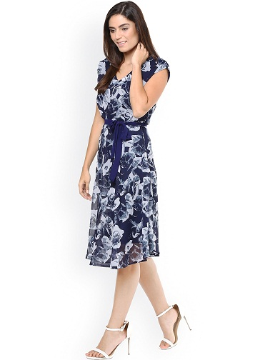 b72f634a8 A navy blue woven floral print A-line dress will take to make gorgeous. You  can put forward this types of V-neck, short sleeves printed frock for party  wear ...