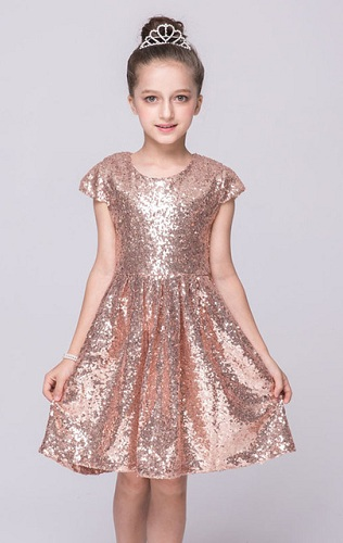 1811fc9015d Choose this wonderful sequined party dress for 10 year olds. This dress is  fully made with sequined material that gives the dress a shiny effect.