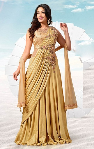 7acd29a1b23 This is a trendy party wear frock for ladies. This new golden color long  dress is a saree inspired one. This will look like a saree from front view.