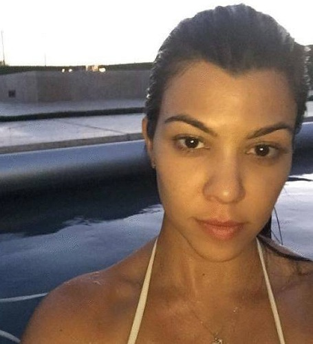Kourtney looked like a sultry siren in this pic. Her skin is so flawless and radiant. She opted for a neat tied up pony tail and a halter neck white bikini.
