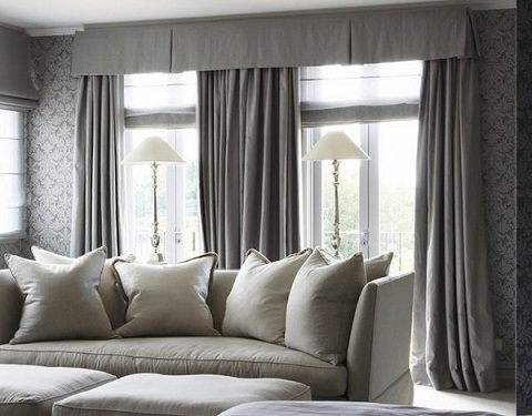 It Is Grey Valance Curtain Having Tough Each Window Consists Of Two Plain Curtains Hanging On Both Sides Even The Wall Has Same
