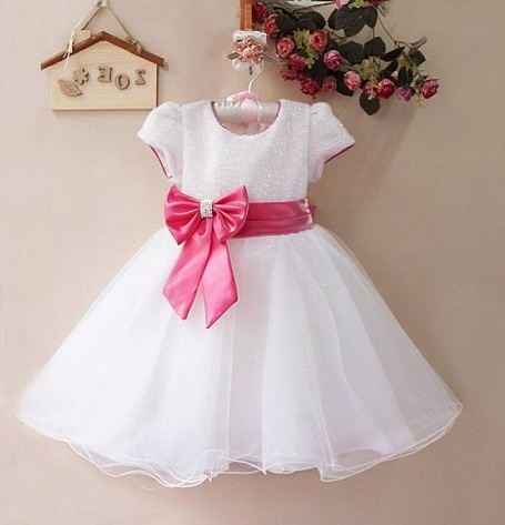4e1126f7426f3 Choose this stunning white dress with a big pink bow for your baby s big  day. This party wear frock for 1 year old is so simple yet so elegant.