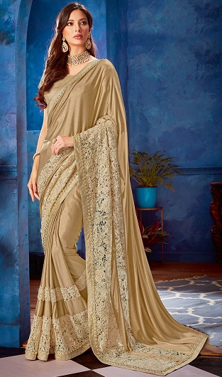 a24dd417cb40bc This Shimmer Golden Saree is quite a stunner. It is made with the best  quality lace border that is fit for the queen. This elegant saree has been  tastefully ...