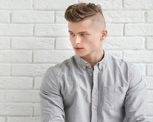 Handsome Young Man Posing on White Brick