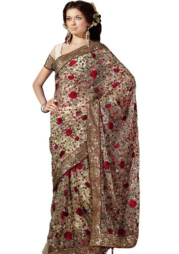 84f6ad37c Have an elite wedding to attend? Check out this Heavy Zardosi Saree in net  material. The saree is embellished all over with beautiful red roses and ...