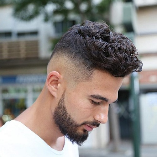 High Bald Fade with Curly Hair and Part