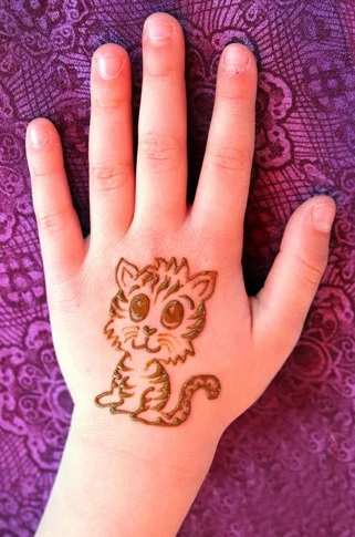 c9a927594e058 This is a beautiful and cute baby mehndi design with just a little kitten  made on the back of the palm. The kitten has a big button like eyes making  it look ...