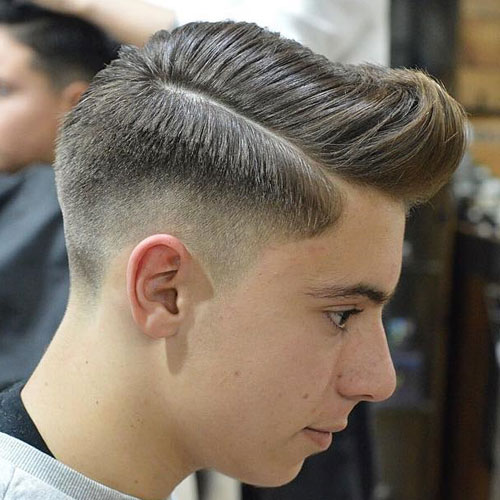 Pompadour with Hard Part and Mid Skin Fade