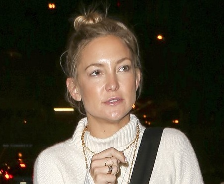 She wore a white polo neck knitted shirt and cute little sock bun. Her skin looked amazing inspite of wearing no makeup. She illustrates how less ...