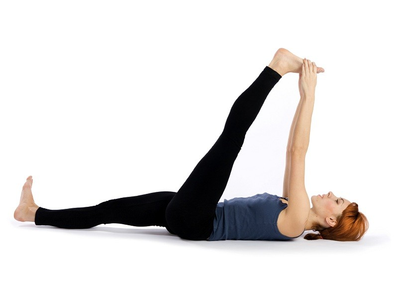 Woman doing Stretching Yoga Exercise