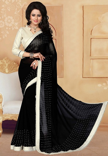 7043773f8a07ac This starry black saree is perfectly contrasted with a three-fourth sleeves  blouse in shimmer fabric. It has a Chinese collar neck which is ...