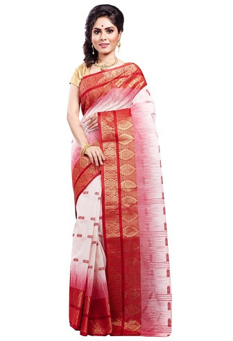 9511151353 Red and white are two widely used colours in Bengal cotton saris. This  classic combination is once again repeated in this saree using the shading  technique.