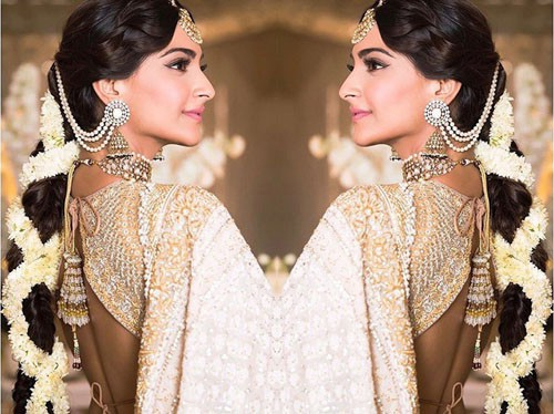 Flower Rolled Hairstyle for Lehenga